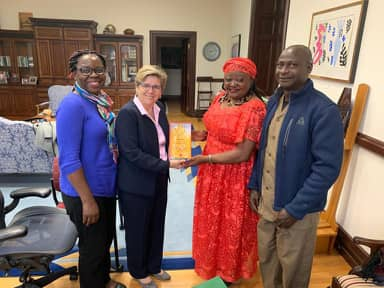 Award presentation to Gallaudet President on behalf of Nigerian Deaf Women by the National Women Leader Charity James Diyoung.
